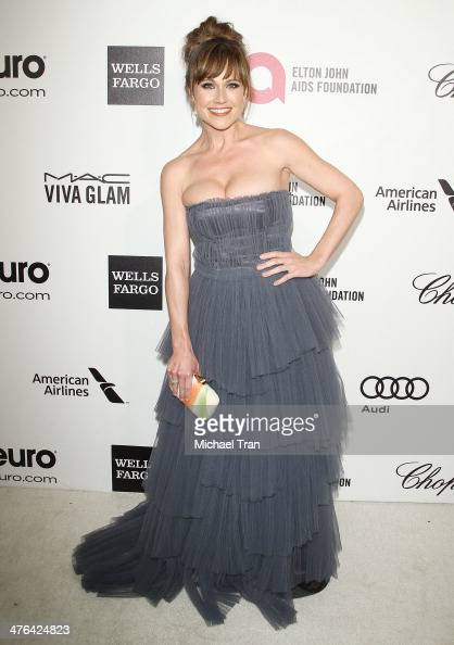 Nikki Deloach arrives at the 22nd Annual Elton John AIDS Foundation's Oscar viewing party held on March 2 2014 in West Hollywood California