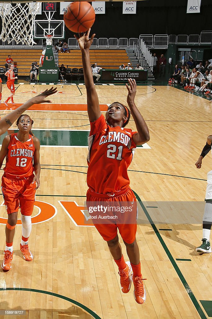 Nikki Dixon #21 of the Clemson Lady Tigers goes to the basket for two points against the Miami Hurricanes on January 3, 2013 at the BankUnited Center in Coral Gables, Florida. Miami defeated Clemson 78-56.