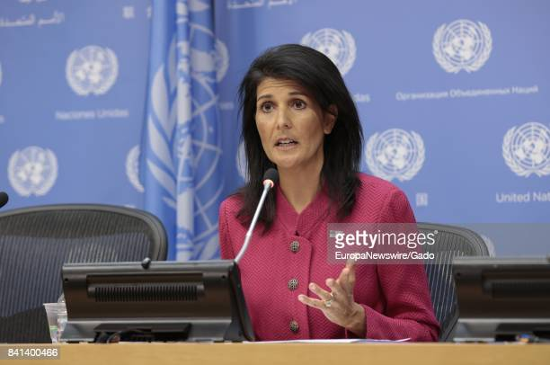 Nikki Haley United States Permanent Representative to the United Nations with one hand raised in the midst of explaining a point during a press...