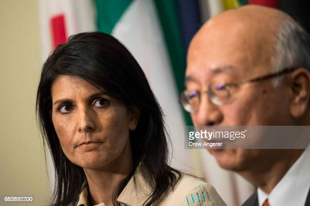 Nikki Haley US ambassador to the United Nations looks on as Koro Bessho Japanese ambassador to the United Nations speaks during a press briefing...