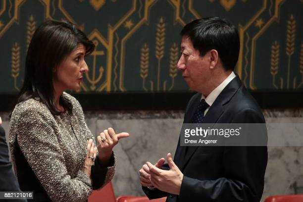 Nikki Haley US ambassador to the United Nations talks with Wu Haitao Chinese deputy ambassador to the United Nations at the conclusion of an...