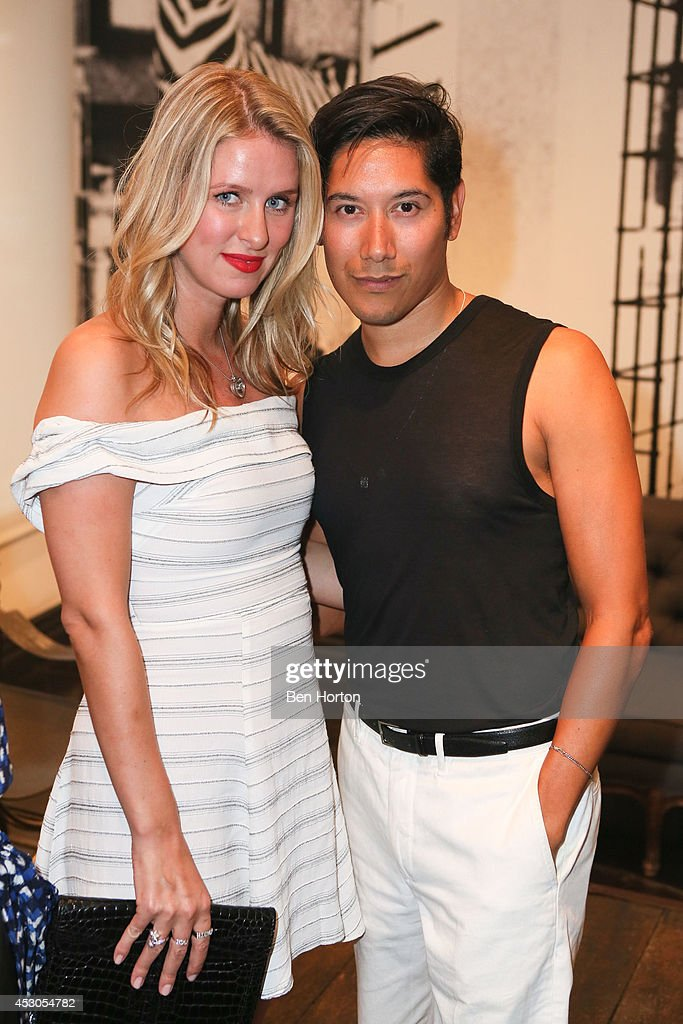 Nikki Hilton and Carlos Lopez attend Nicole Richie, Eric Buterbaugh and Nevena Borissova host Ryan Korban's 'Luxury Redefined' on August 1, 2014 in Los Angeles, California.