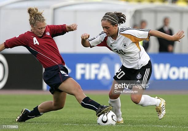Nikki Krzysik of the United States vies for the ball with Nadine Kessler of Germany during the FIFA Women's Under 20 World Championships Quarterfinal...