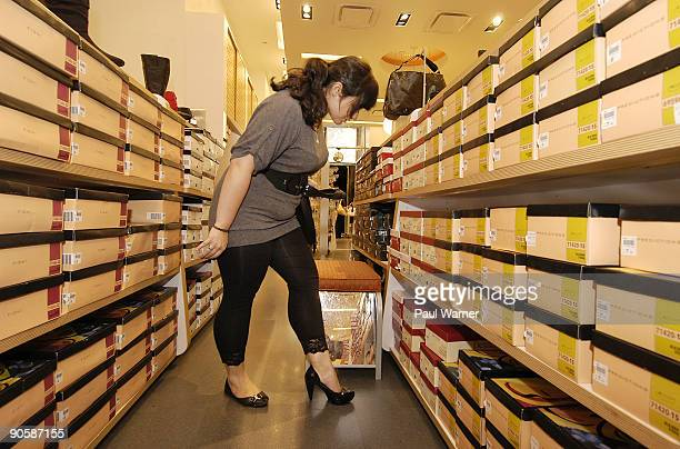 Nikki Liberatore of Yonkers NY tries on shoes at the downtown shopping party at Payless ShoeSource on September 10 2009 in New York City