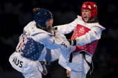 Nikki Martinez of Puerto Rico competes with Eve Ember of Australia during the women's 73 kg combat of WTF World Taekwondo Championships 2013 at the...