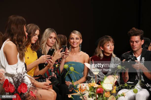 Nikki Phillips Ksenija Lukich Anna Heinrich Yan Yan Chan and Nathan Joliffe watch the C/meo Collective show at MercedesBenz Fashion Week Resort 18...