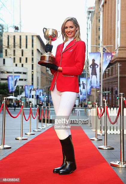 Nikki Phillips poses with the Melbourne Cup at Martin Place on August 18 2015 in Sydney Australia