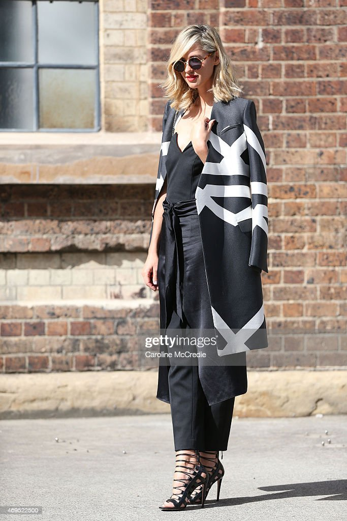 Nikki Phillips wearing a Camilla and Marc coat at MercedesBenz Fashion Week Australia 2015 at Carriageworks on April 13 2015 in Sydney Australia