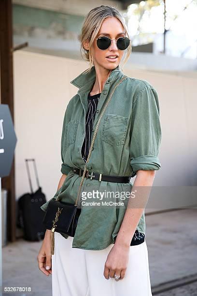 Nikki Phillips wearing Watson x Watson shirt Finders Keepers pants Jimmy Choo heels YSL handbag and RayBan sunglasses arrives ahead of the PE Nation...