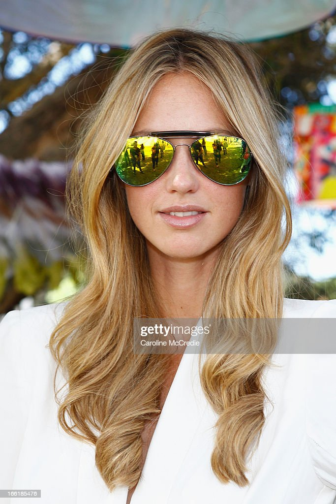 Nikki Phillips wears Tony Bianco glasses, House of Emmanuele ring and Alice McCall outfit as she attends the Camilla show during Mercedes-Benz Fashion Week Australia Spring/Summer 2013/14 at Centennial Park on April 10, 2013 in Sydney, Australia.