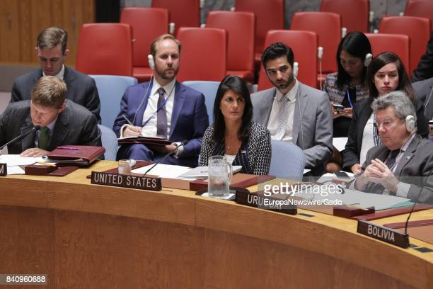 Nikki R Haley United States Permanent Representative to the UN as well as representatives from Uruguay and Bolivia listen gravely during a Security...