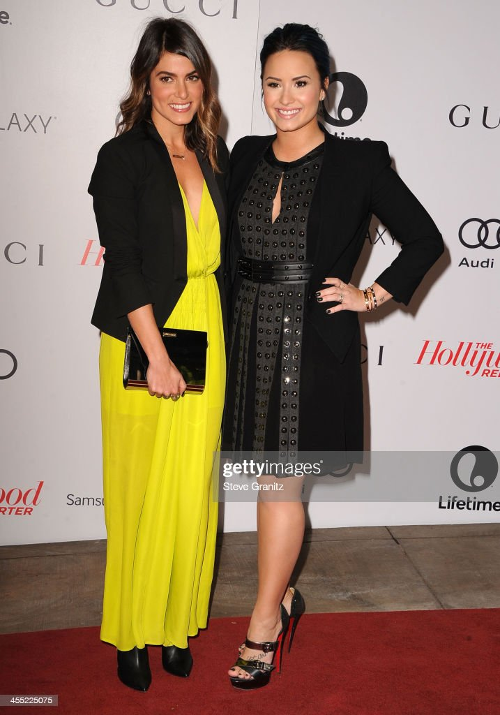 Nikki Reed and Demi Lovato arrives at the The Hollywood Reporter's Women In Entertainment Breakfast Honoring Oprah Winfrey at Beverly Hills Hotel on December 11, 2013 in Beverly Hills, California.