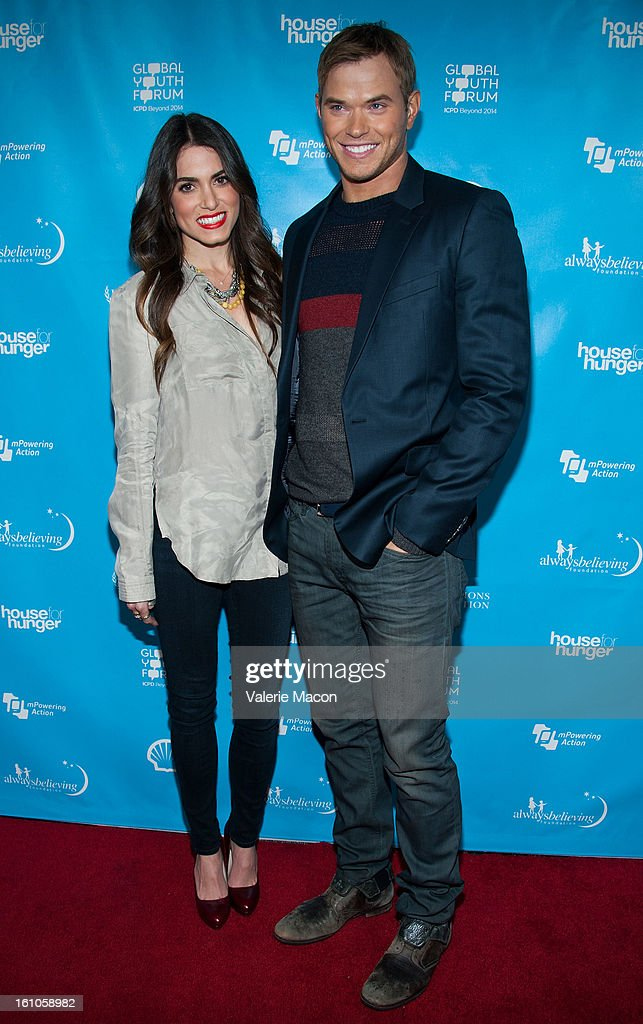 Nikki Reed and Kellan Lutz arrives at the mPowering ActionPre-GRAMMY Launch Event at The Conga Room at L.A. Live on February 8, 2013 in Los Angeles, California.