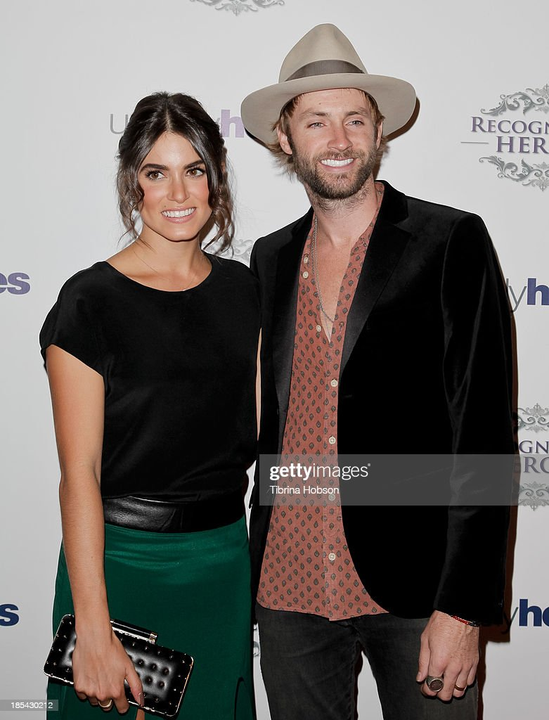Nikki Reed and Paul McDonald attend at the Unlikely Heroes' recognizing heroes awards dinner And gala at W Hollywood on October 19, 2013 in Hollywood, California.