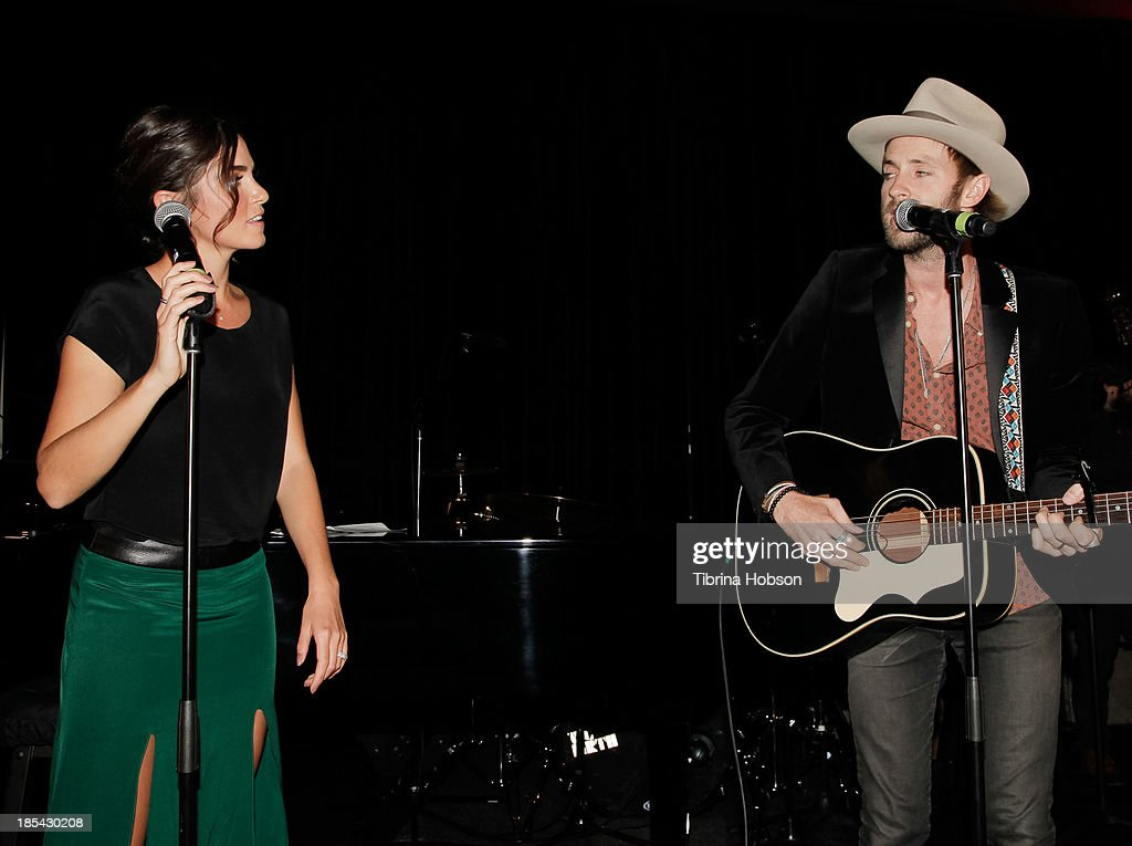 Nikki Reed and Paul McDonald perform at the Unlikely Heroes' recognizing heroes awards dinner And gala at W Hollywood on October 19, 2013 in Hollywood, California.