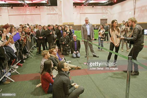Nikki Reed sings a song with her husband Paul McDonald from the movie soundtrack watched by Kellan Lutz at a fan event for the film Twilight Saga...