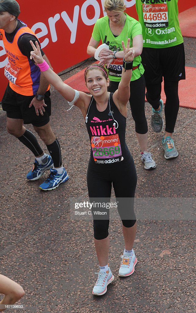 Nikki Sanderson poses at the finish line at the 2013 Virgin London M on April 21, 2013 in London, England.