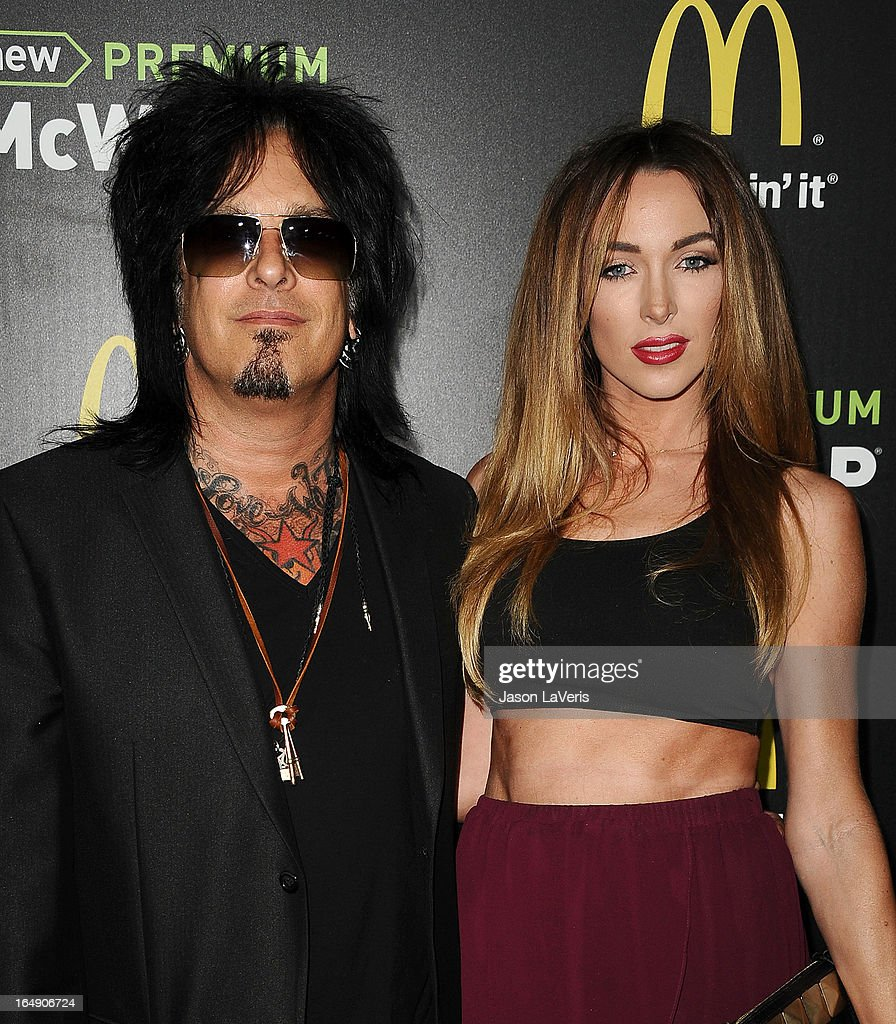 Nikki Sixx and Courtney Bingham attend the McDonald's Premium McWrap launch party at Paramount Studios on March 28 2013 in Hollywood California