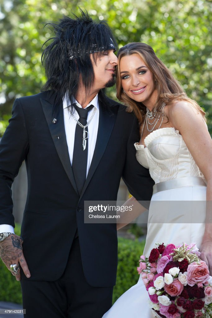 Nikki Sixx and Courtney Sixx pose for portraits during their wedding at Greystone Mansion on March 15 2014 in Beverly Hills California
