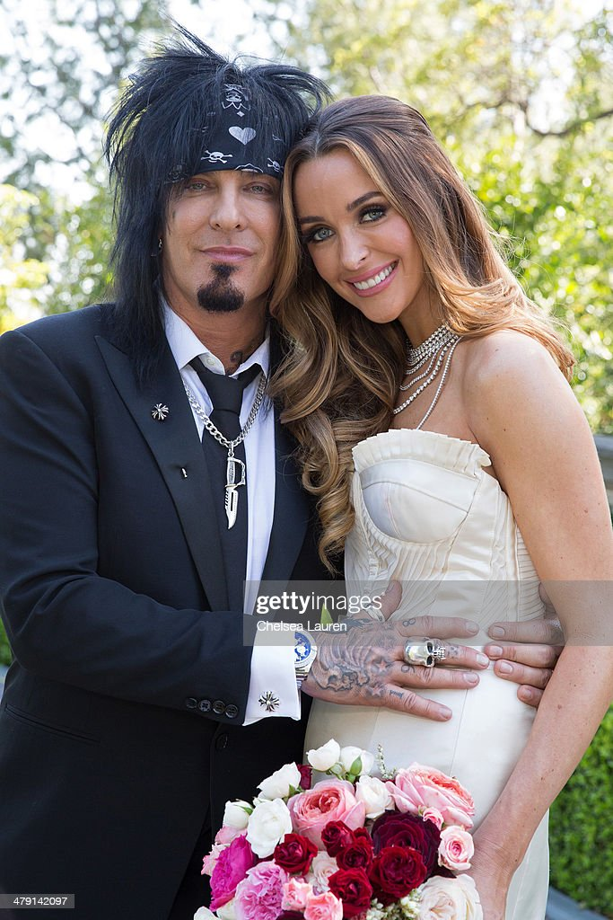 Nikki Sixx (L) and Courtney Sixx pose for portraits during their wedding at Greystone Mansion on March 15, 2014 in Beverly Hills, California.