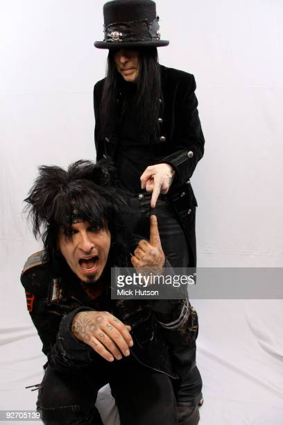 Nikki Sixx and Mick Mars of Motley Crue pose for a studio portrait session backstage at the Download Festival Donington Park Leicestershire on June...
