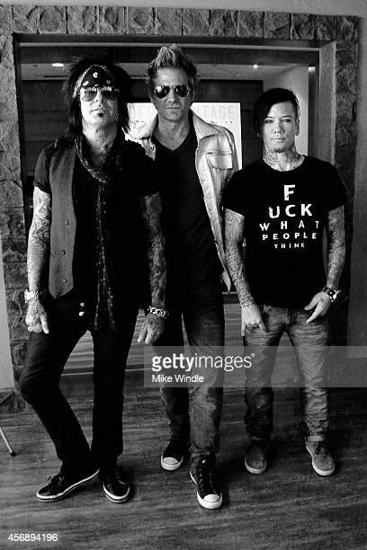 Nikki Sixx James Michael and DJ Ashba of SIXXAM sign copies of their new album 'Modern Vintage' at firstever instore appearance at Best Buy on...