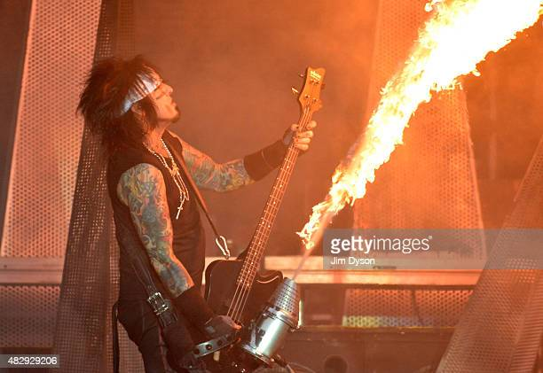 Nikki Sixx of Motley Crue performs live on stage on Day 3 of the Download Festival at Donington Park on June 14 2015 in Castle Donington England