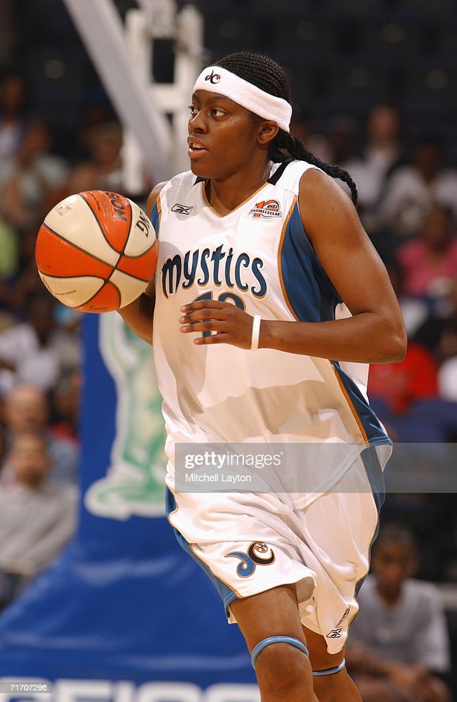 Nikki Teasley #42 of the Washington Mystics moves the ball up court during a game against the Detroit Shock at MCI Center on August 11, 2006 in Washington, D.C. The Mystics won 78-66.