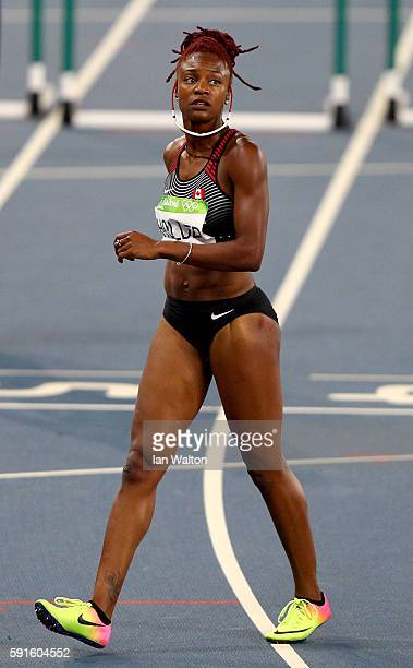 Nikkita Holder of Canada reacts during the Women's 100m Hurdles Semifinals on Day 12 of the Rio 2016 Olympic Games at the Olympic Stadium on August...