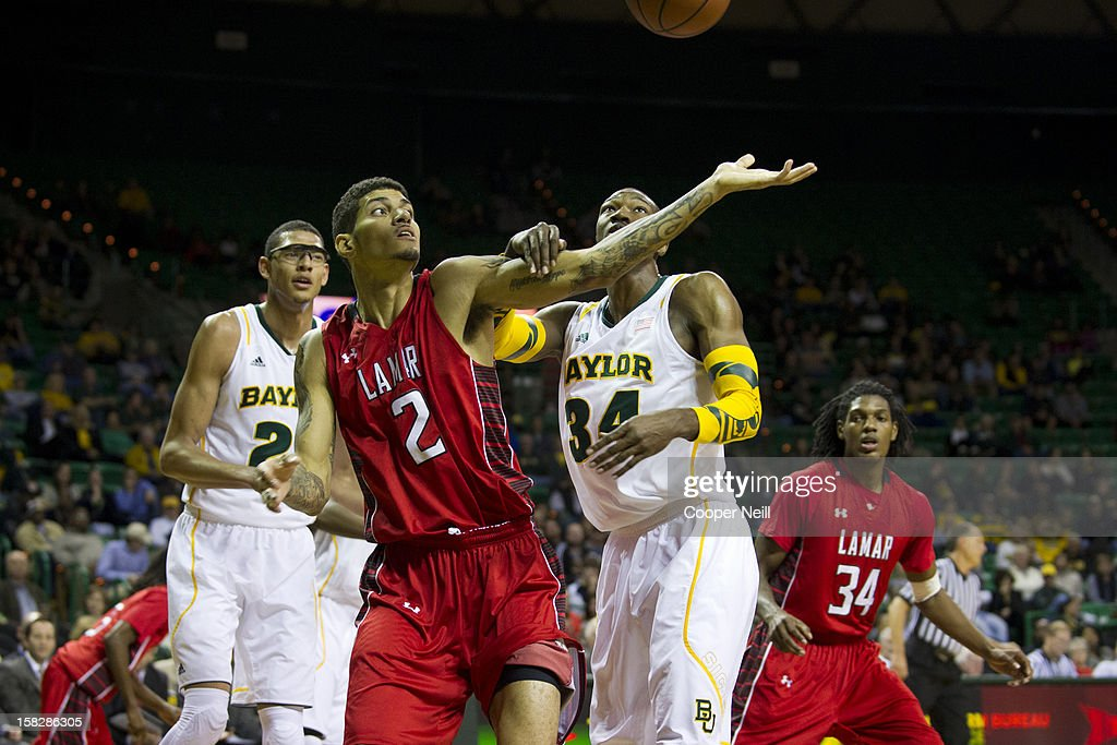 Nikko Acosta #2 of the Lamar Cardinals and Cory Jefferson #34 of the Baylor University Bears fight for a rebound on December 12, 2012 at the Ferrell Center in Waco, Texas.