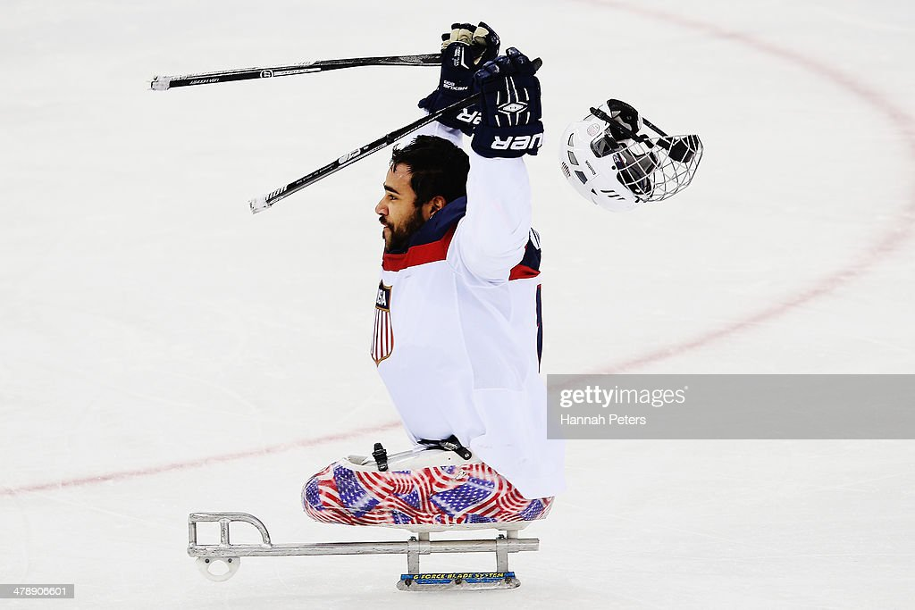 Nikko Landeros of the USA celebrates after winning the ice sledge hockey gold medal game between the Russian Federation and the United States of America at the Shayba Arena during day eight of the 2014 Paralympic Winter Games on March 15, 2014 in Sochi, Russia.