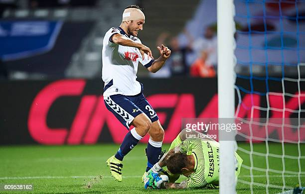 Niklas Backman of AGF Aarhus and Goalkeeper Johan Dahlin of FC Midtjylland compete for the ball during the Danish Alka Superliga match between AGF...