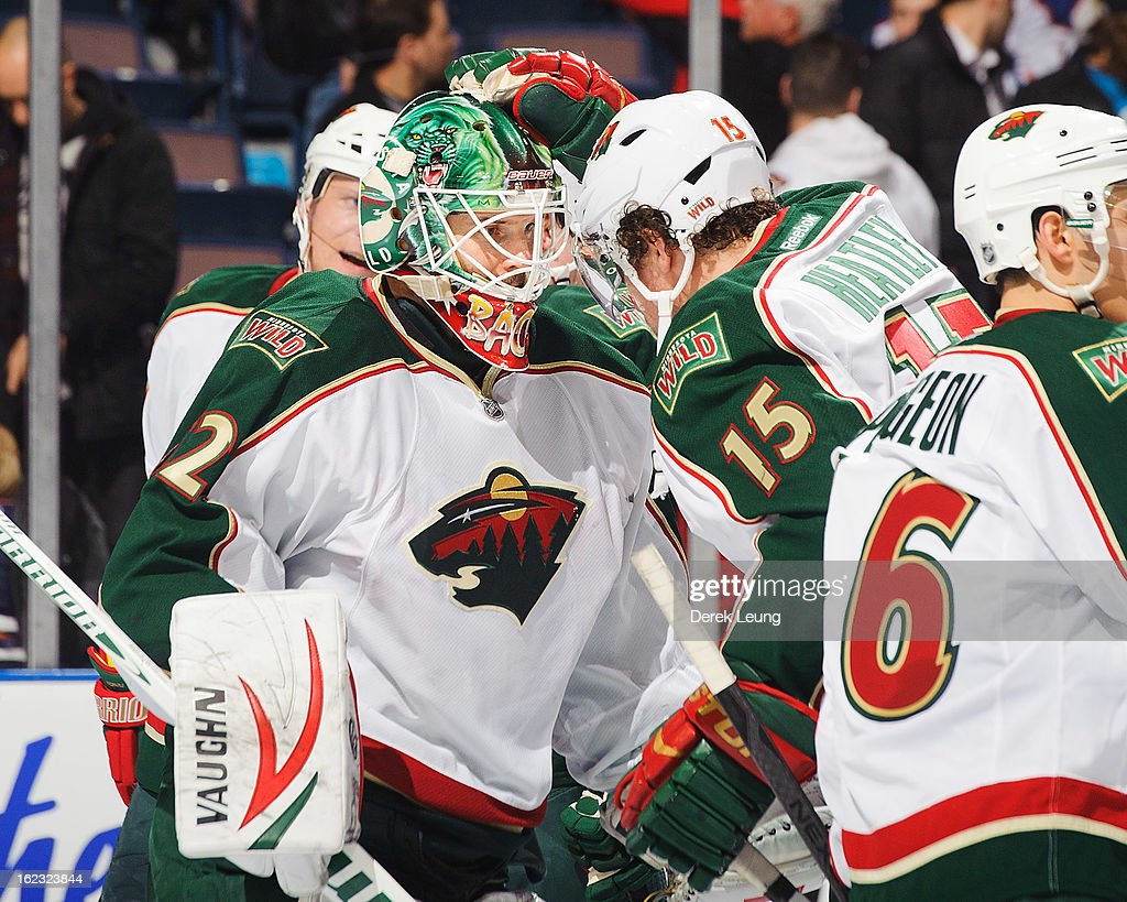 Niklas Backstrom #32 and <a gi-track='captionPersonalityLinkClicked' href=/galleries/search?phrase=Dany+Heatley&family=editorial&specificpeople=202142 ng-click='$event.stopPropagation()'>Dany Heatley</a> #15 of the Minnesota Wild celebrate their victory over the Edmonton Oilers during an NHL game at Rexall Place on February 21, 2013 in Edmonton, Alberta, Canada.