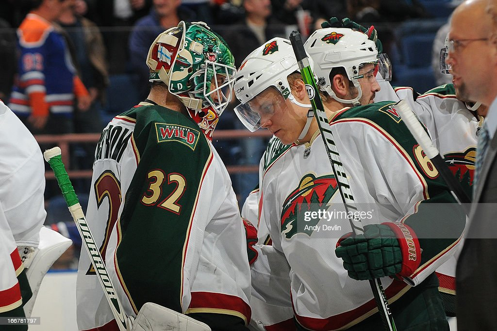 Niklas Backstrom and <a gi-track='captionPersonalityLinkClicked' href=/galleries/search?phrase=Mikael+Granlund&family=editorial&specificpeople=5649678 ng-click='$event.stopPropagation()'>Mikael Granlund</a> #64 of the Minnesota Wild celebrate after winning the game against the Edmonton Oilers on April 16, 2013 at Rexall Place in Edmonton, Alberta, Canada.