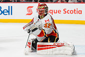 Niklas Backstrom of the Calgary Flames makes a glove save in the second period during the NHL game against the Montreal Canadiens at the Bell Centre...