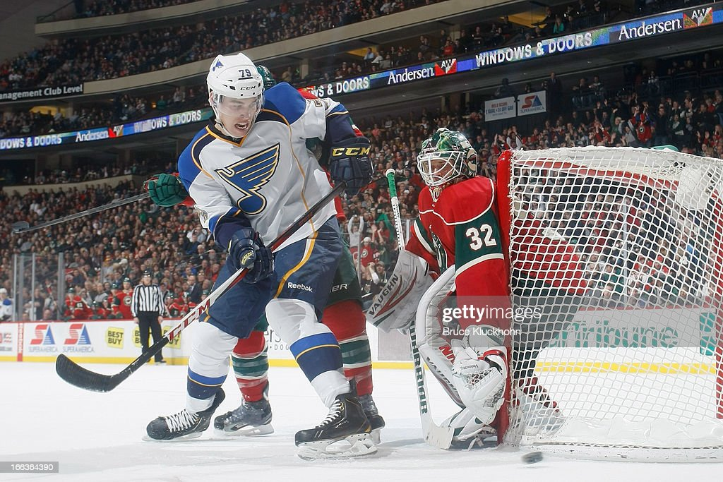Niklas Backstrom #32 of the Minnesota Wild defends his goal against <a gi-track='captionPersonalityLinkClicked' href=/galleries/search?phrase=Adam+Cracknell&family=editorial&specificpeople=2221797 ng-click='$event.stopPropagation()'>Adam Cracknell</a> #79 and the St. Louis Blues during the game on April 11, 2013 at the Xcel Energy Center in Saint Paul, Minnesota.