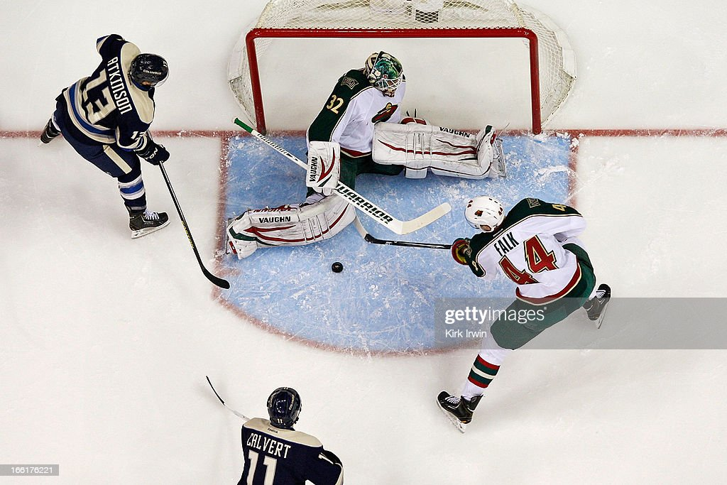 Niklas Backstrom #32 of the Minnesota Wild makes a save against Cam Atkinson #13 of the Columbus Blue Jackets as Justin Falk #44 controls the rebound on April 7, 2013 at Nationwide Arena in Columbus, Ohio. Minnesota defeated Columbus 3-0.