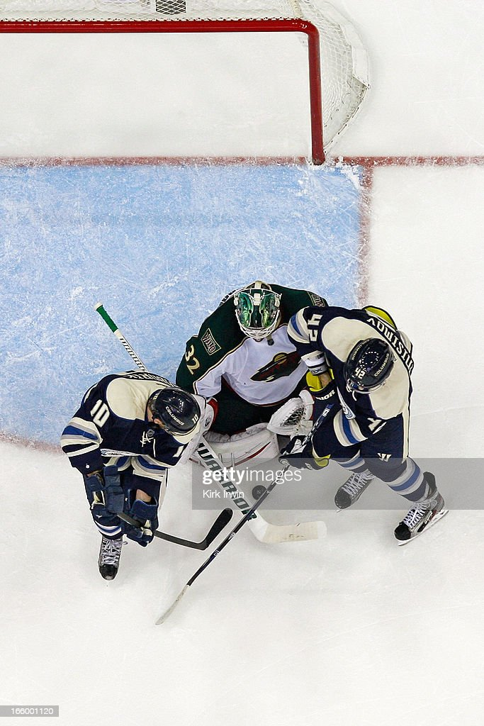 Niklas Backstrom #32 of the Minnesota Wild makes a save as <a gi-track='captionPersonalityLinkClicked' href=/galleries/search?phrase=Marian+Gaborik&family=editorial&specificpeople=202477 ng-click='$event.stopPropagation()'>Marian Gaborik</a> #10 of the Columbus Blue Jackets and Artem Ansimov #42 of the Columbus Blue Jackets look for a rebound during the third period on April 7, 2013 at Nationwide Arena in Columbus, Ohio. Backstrom stopped 24 shots as Minnesota shut out Columbus 3-0.