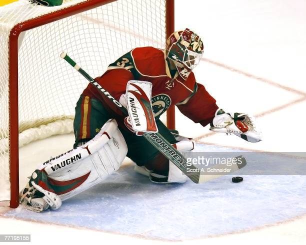 Niklas Backstrom of the Minnesota Wild makes one of his 27 saves in a shutout of the Chicago Blackhawks October 4 2007 at the Xcel Energy Center in...