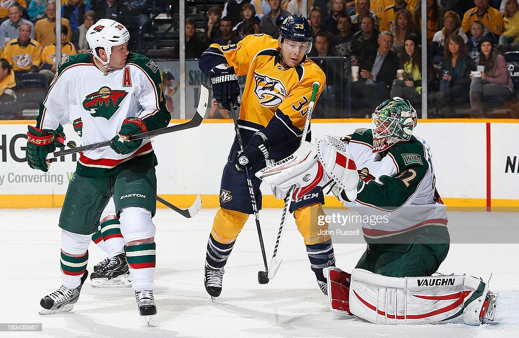 Niklas Backstrom #32 of the Minnesota Wild stops a shot against Colin Wilson #33 of the Nashville Predators as Wild <a gi-track='captionPersonalityLinkClicked' href=/galleries/search?phrase=Ryan+Suter&family=editorial&specificpeople=583306 ng-click='$event.stopPropagation()'>Ryan Suter</a> #20 defends during an NHL game at the Bridgestone Arena on March 9, 2013 in Nashville, Tennessee.