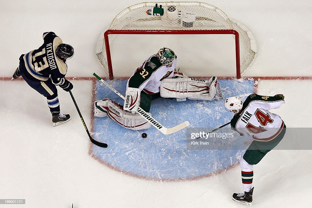 Niklas Backstrom #32 of the Minnesota Wild stops a shot from <a gi-track='captionPersonalityLinkClicked' href=/galleries/search?phrase=Cam+Atkinson&family=editorial&specificpeople=6270272 ng-click='$event.stopPropagation()'>Cam Atkinson</a> #13 of the Columbus Blue Jackets as <a gi-track='captionPersonalityLinkClicked' href=/galleries/search?phrase=Justin+Falk&family=editorial&specificpeople=4324950 ng-click='$event.stopPropagation()'>Justin Falk</a> #44 looks to control the rebound during the first period on April 7, 2013 at Nationwide Arena in Columbus, Ohio. Backstrom stopped 24 shots as Minnesota defeated Columbus 3-0.