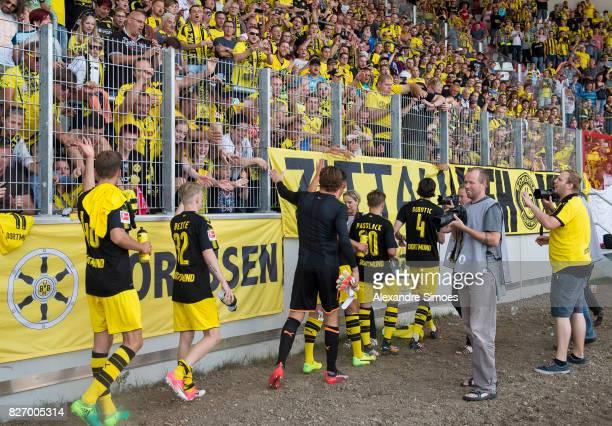 Niklas Beste goal keeper Roman Weidenfeller Neven Subotic JanniLuca Serra and Felix Passlack of Borussia Dortmund together with the fans after the...