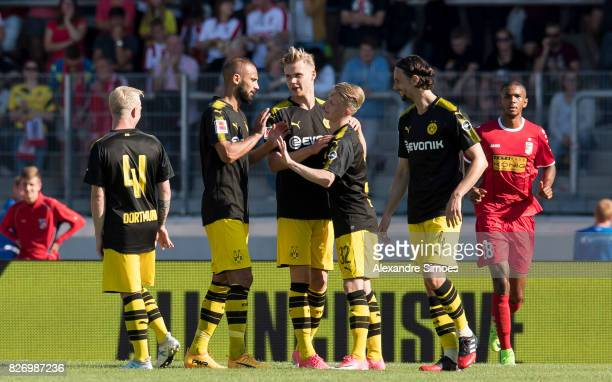 Niklas Beste of Borussia Dortmund celebrates after scoring the goal to the 12 together with Oemer Toprak during the preseason friendly match between...