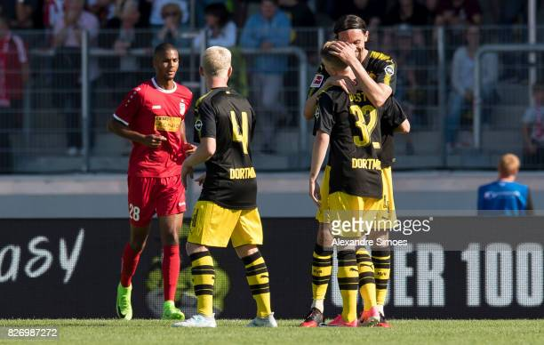Niklas Beste of Borussia Dortmund celebrates after scoring the goal to the 12 together with Neven Subotic during the preseason friendly match between...