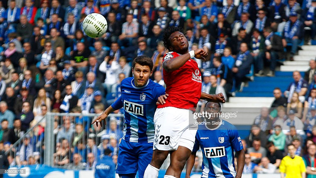 Niklas Brandt and David Kinsombi of Magdeburg challenges Roussel Ngankam of Sonnenhof-Grossaspach during the Third League match between 1. FC Magdeburg and SG Sonnenhof-Grosssaspach at MDCC-Arena on April 30, 2016 in Magdeburg, Germany.