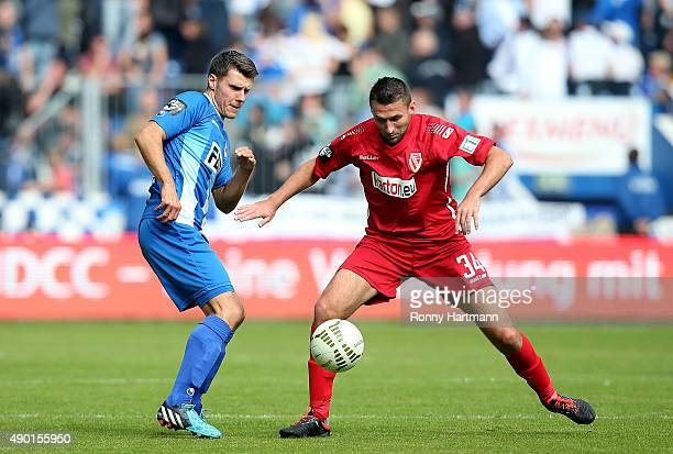 Niklas Brandt of Magdeburg and Torsten Mattuschka of Cottbus vie during the Third Liga match between 1 FC Magdeburg and Energie Cottbus at MDCCArena...