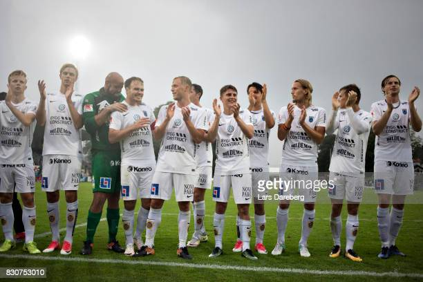 Niklas Busch Thor of IK Sirius FK and his team celebrate after the Allsvenskan match between Halmstad BK and Sirius FK at Orjans Vall on August 12...