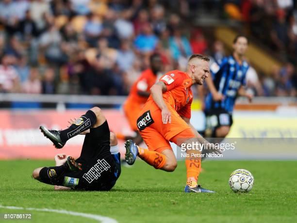 Niklas Busch Thor of IK Sirius FK is injured in his shoulder in a duell with Alexander Michel of Athletic FC Eskilstuna during the Allsvenskan match...