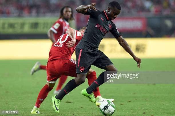 Niklas Dorsch of Bayern Muenchen and Eddie Nketiah of Arsenal compete for the ball during 2017 International Champions Cup China between FC Bayern...