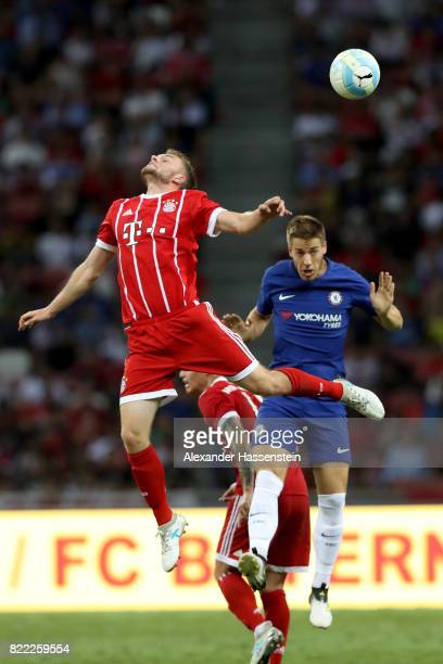 Niklas Dorsch of Bayern Muenchen battles for the ball with Alvaro Morata of Chelsea during the International Champions Cup 2017 match between Bayern...